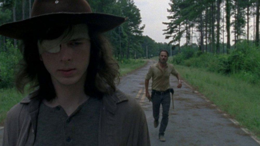 Carl (Chandler Riggs) walks away from his father on The Walking Dead