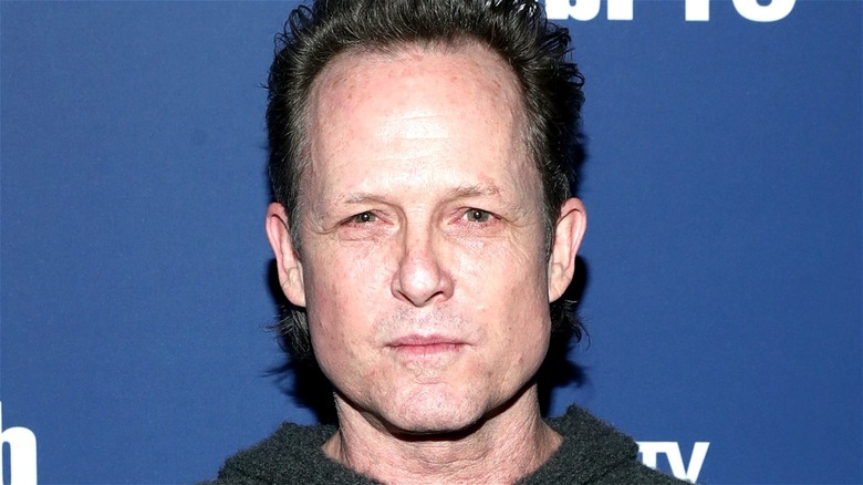 Dean Winters looking at the camera