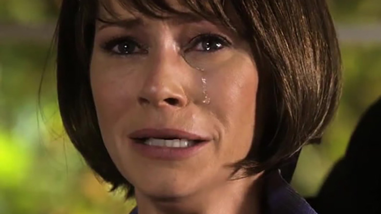 Haley Hotchner crying with a brown wig on in Criminal Minds