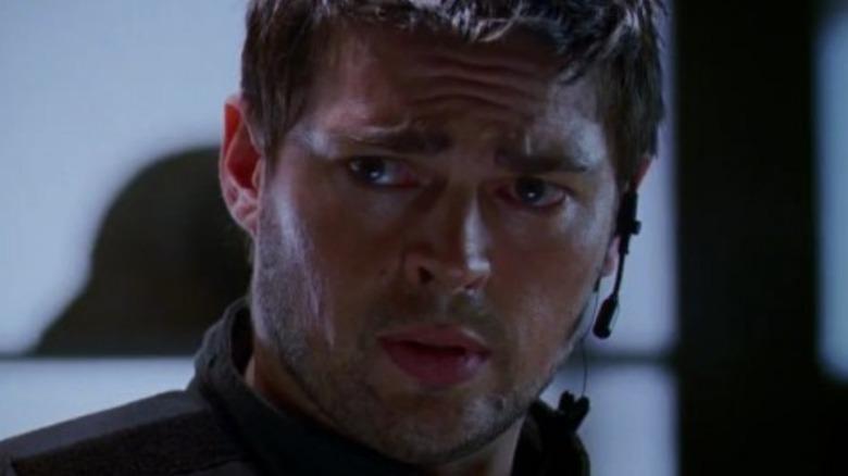 Karl Urban as Reaper looking concerned in Doom