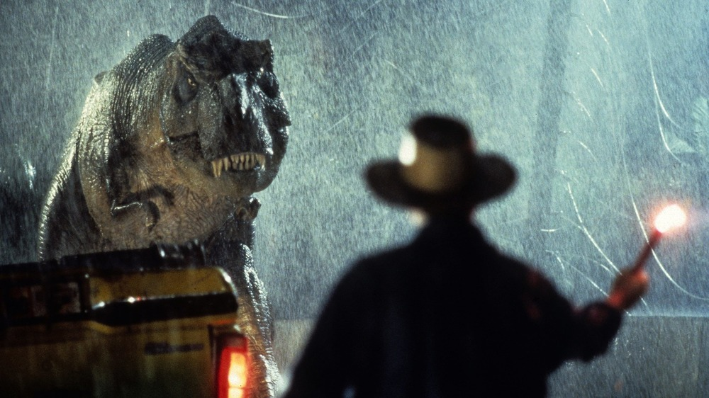 Dr. Grant distracting the T-Rex with a flare