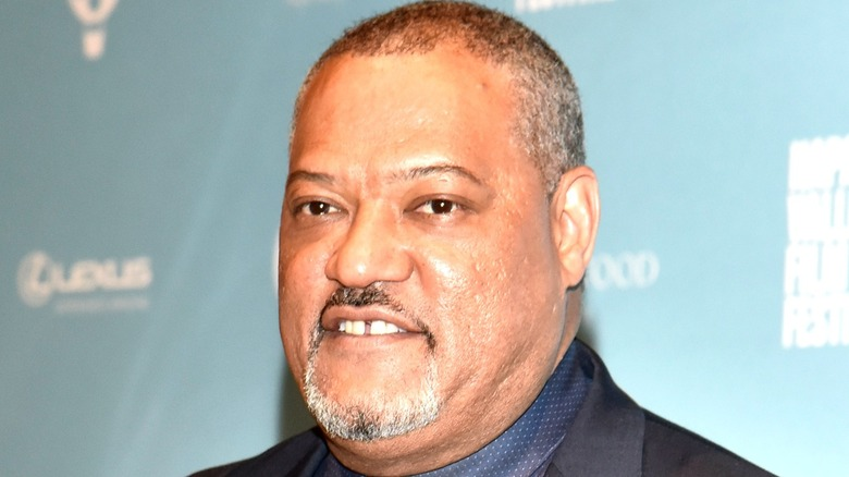 A close up of Laurence Fishburne smiling