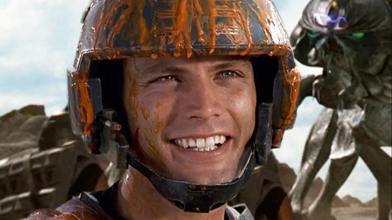 Casper Van Dien as Rico Starship Troopers orange gunk on helmet