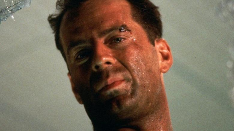 Bruce Willis smirks through broken glass