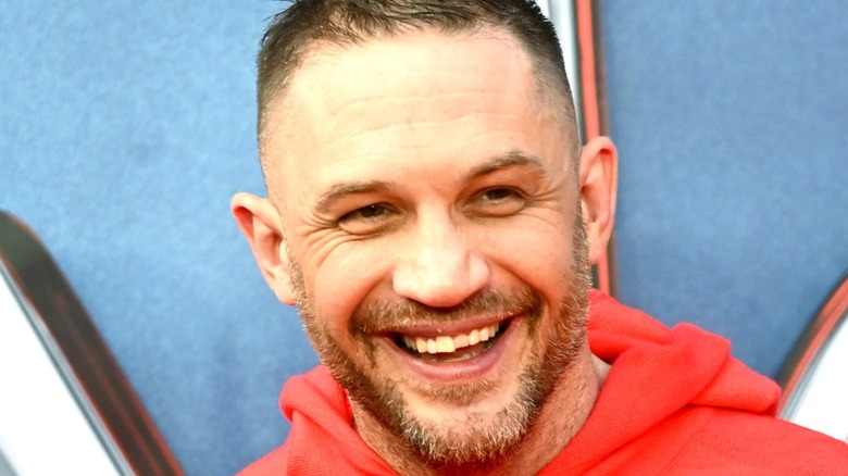 Tom Hardy smiles at event