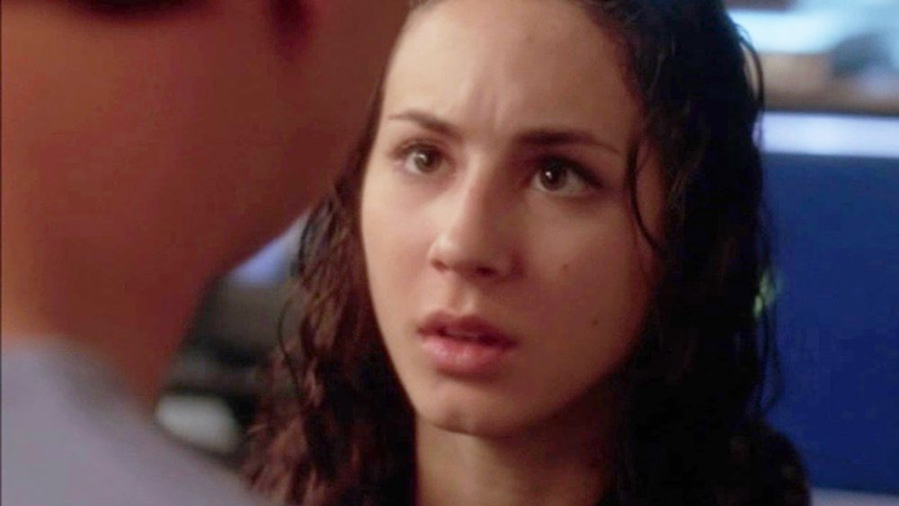 Troian Bellisario as Sarah McGee with wet hair and a scared expression in NCIS