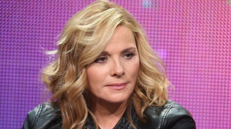 Kim Cattrall sitting looking to the side