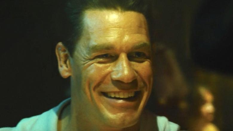 Peacemaker smiling at bar