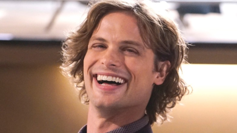 Dr. spencer reid smiling and laughing