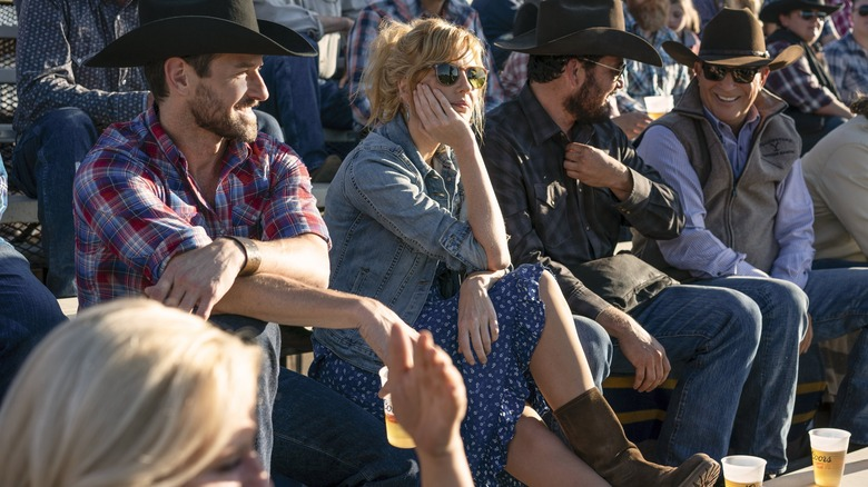 The cast of Yellowstone with some strategically placed Coors cups