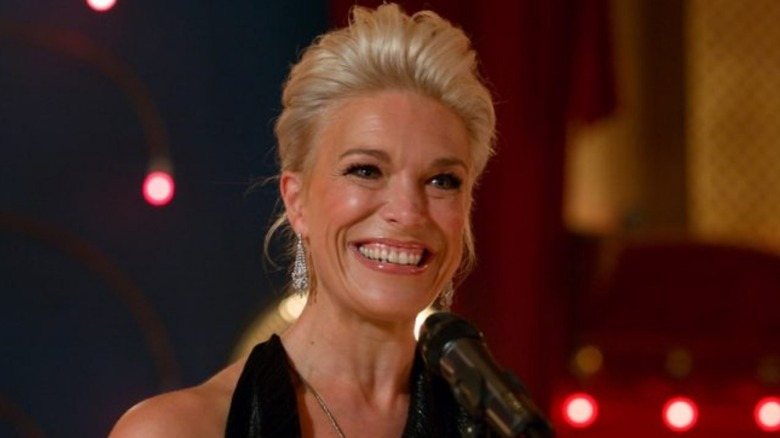 Hannah Waddingham as Rebecca at mic in Ted Lasso