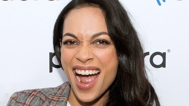 Rosario Dawson grinning