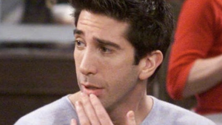 Ross touching his lip