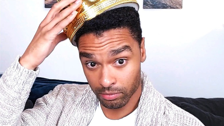 Rege-Jean Page with a crown