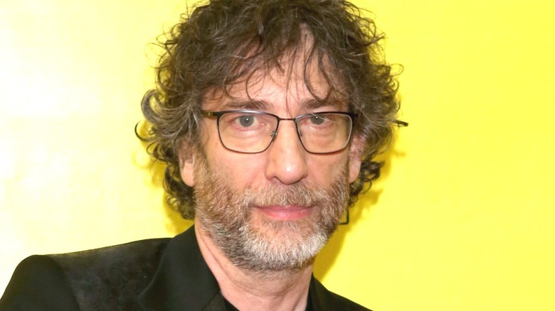 Neil Gaiman wearing glasses
