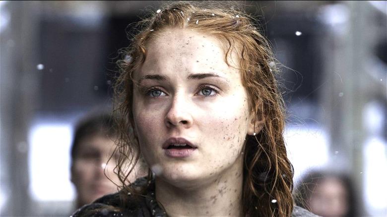 Sansa Stark standing in snowfall