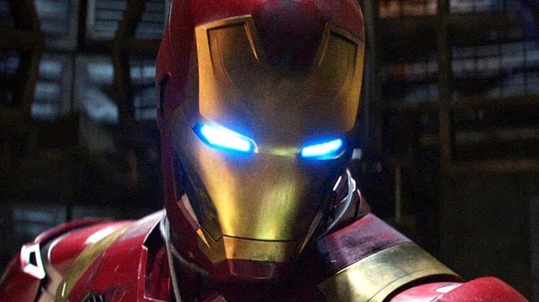 Helmeted Iron Man in close-up during battle