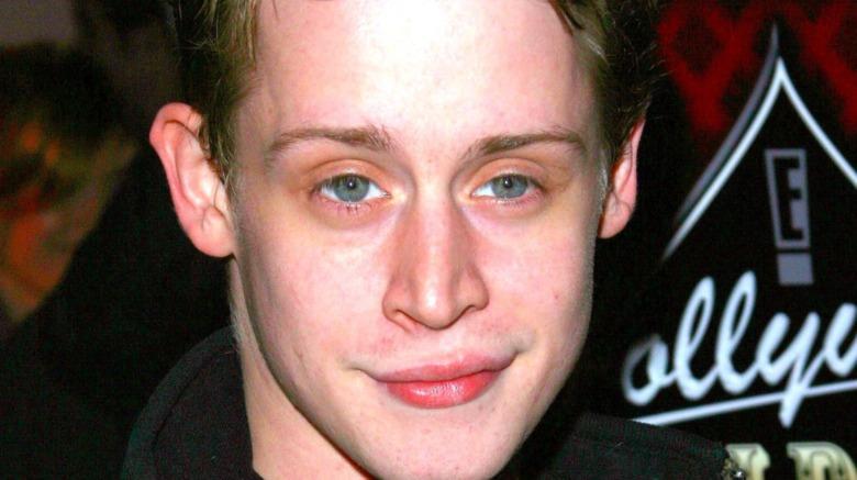 Macaulay Culkin smirking
