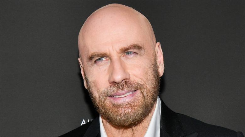 John Travolta posing at event