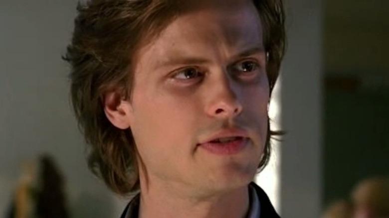 Spencer Reid grimacing