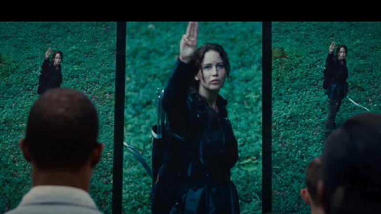 Katniss Everdeen doing the three-finger salute in The Hunger Games