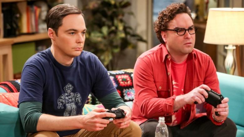 Leonard and Sheldon play video games.