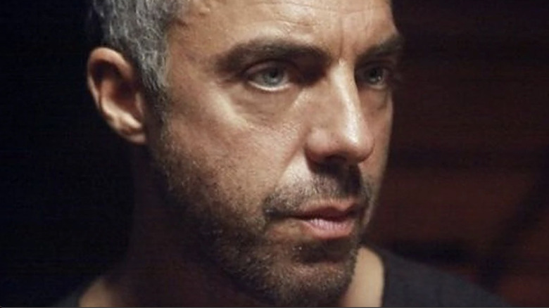Titus Welliver looking right