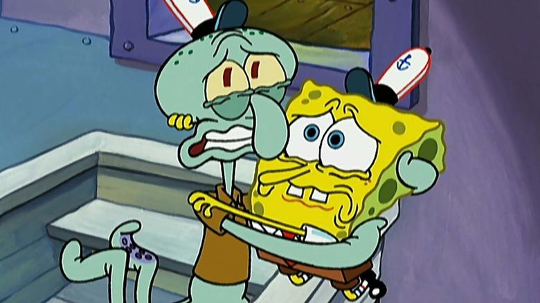 "Squidward and SpongeBob hug each other in ""Graveyard Shift"""