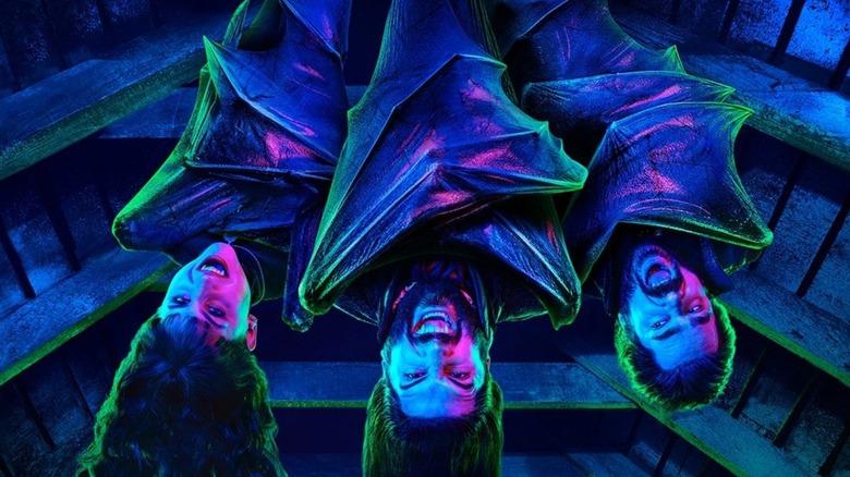Nandor (Kayvan Novak), Laszlo (Matt Berry), and Nadja (Natasia Demetriou) hang around on What We Do in the Shadows poster