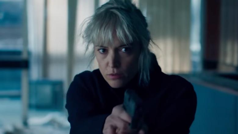 Cecile holding gun