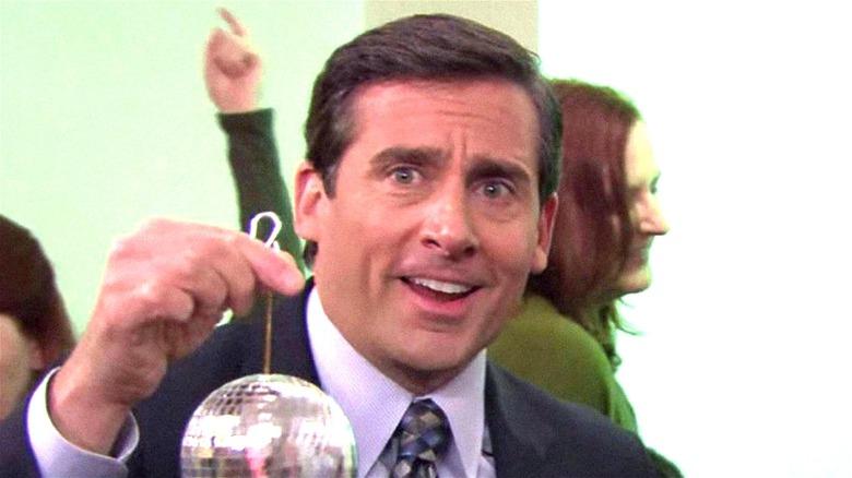 Michael holding a disco ball