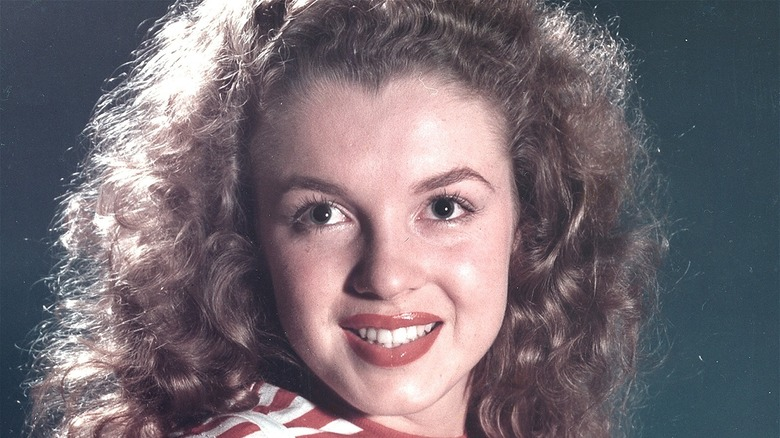 Marilyn Monroe smiling as a young woman