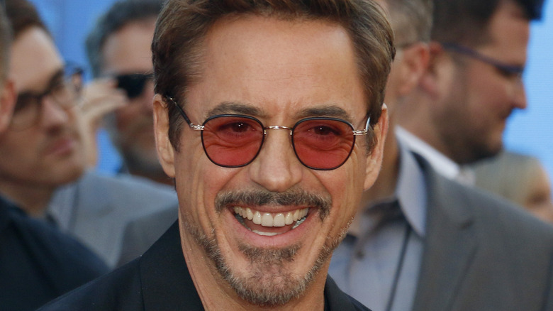 Robert Downey Jr. smiling and wearing red glasses