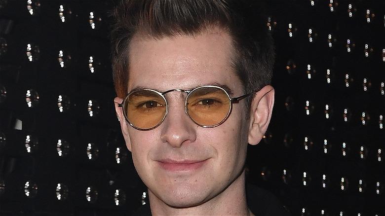 Andrew Garfield wearing yellow glasses