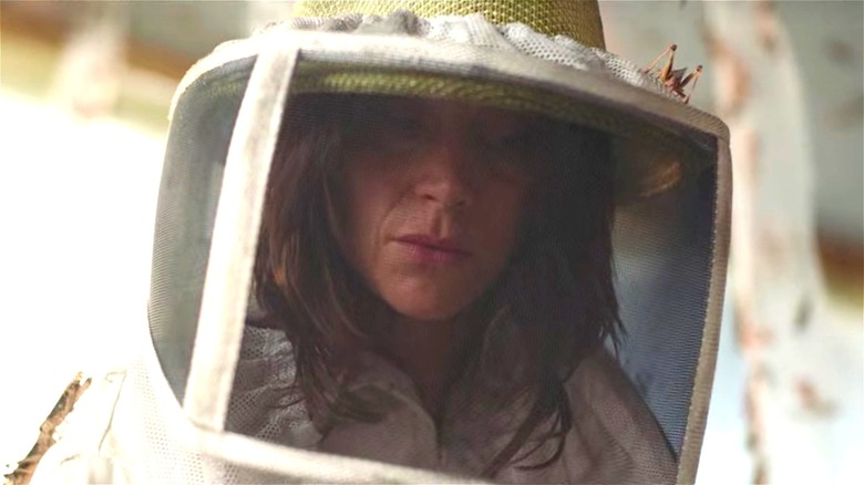 Woman in beekeeper suit