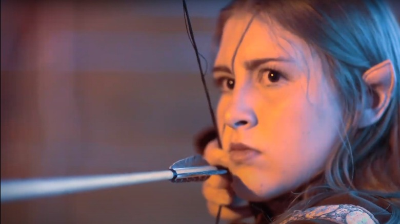 An Evermore cast member as an elven archer in a promotional image