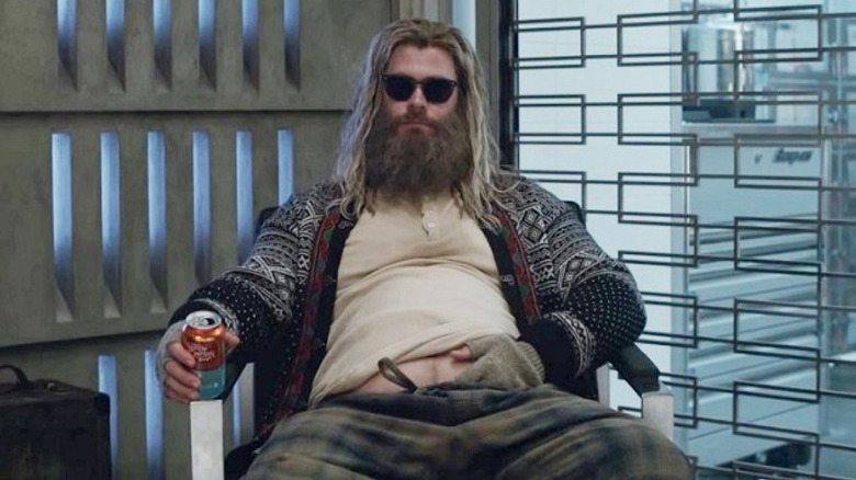 Chris Hemsworth as Thor, holding a can of beer, in Avengers: Endgame