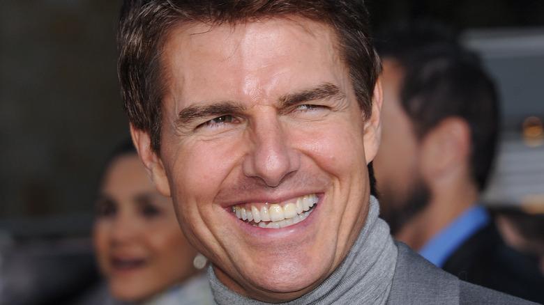 Tom Cruise smiling wearing turtleneck