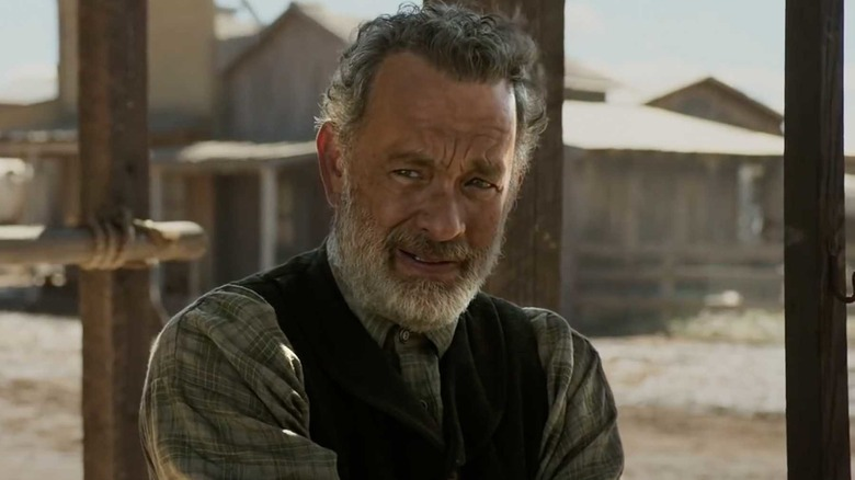 Tom Hanks stands in a frontier town