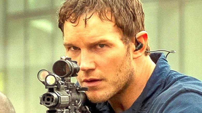 Chris Pratt as Dan with gun