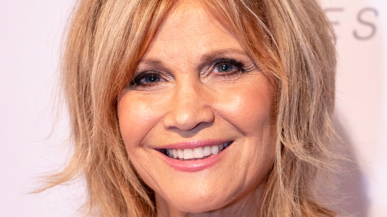 Markie Post smiling on a red carpet