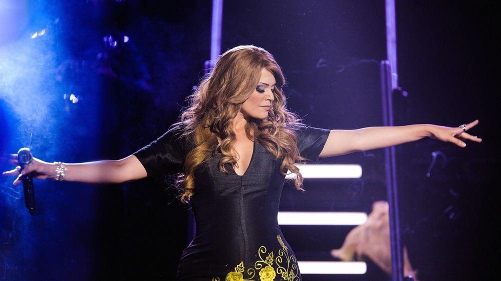 Jenni Rivera performing on stage