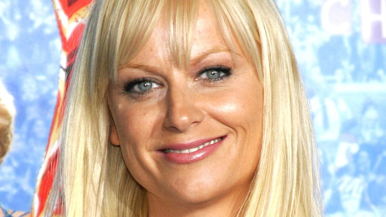 Amy Poehler wears bangs and smiles
