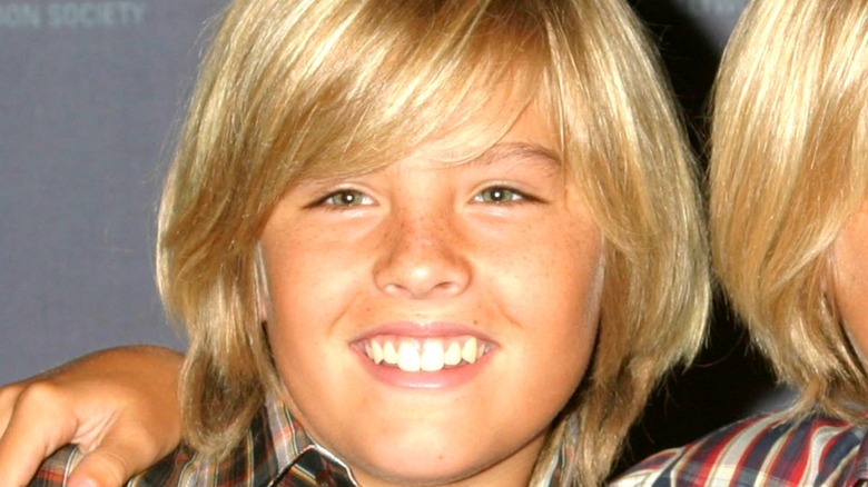 A Sprouse twin posing