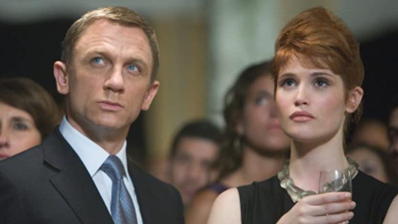 Daniel Craig and Gemma Arterton looking up in Quantum of Solace