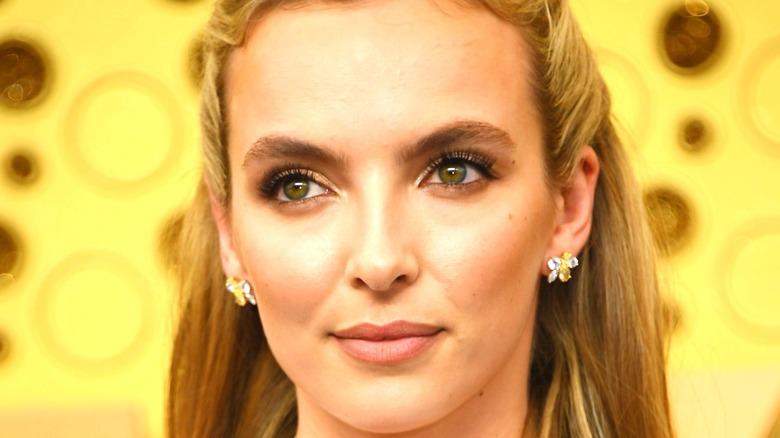 Jodie Comer smiling wearing earrings