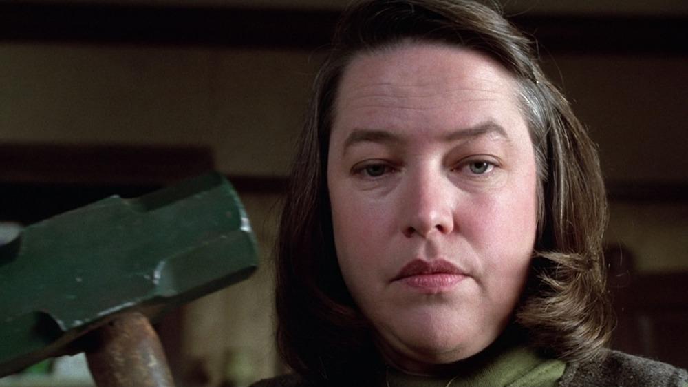 Kathy Baker weilding a sledgehammer in Misery