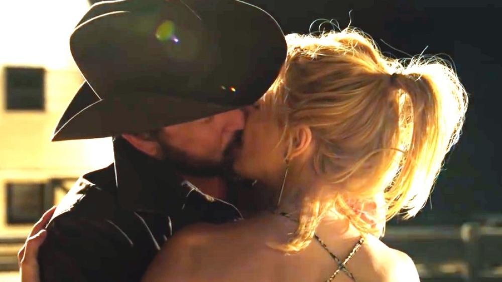 Rip and Beth kissing