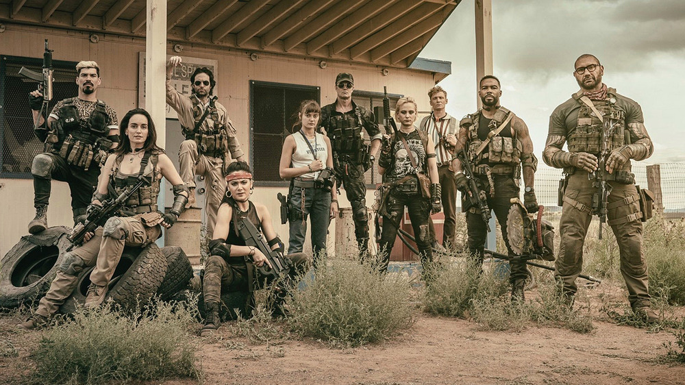 Cast of Army of the Dead armed with weapons