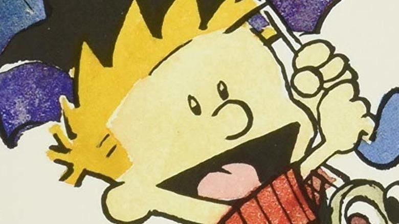 Calvin smiling with umbrella